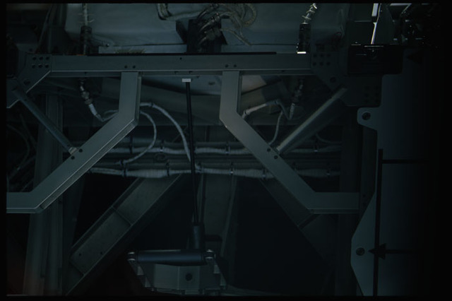 STS110-301-009 - STS-110 - View of a LDU and grapple bar on the Mobile Transporter taken during STS-110