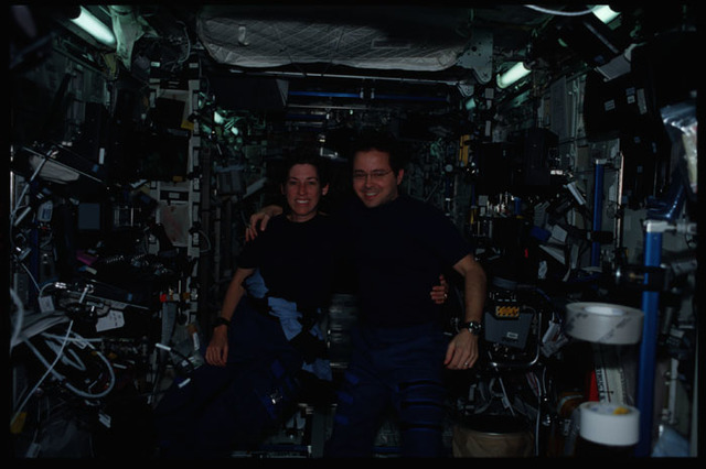 STS110-314-025 - STS-110 - Bursch and Ochoa pose in Destiny during STS-110's visit to the ISS