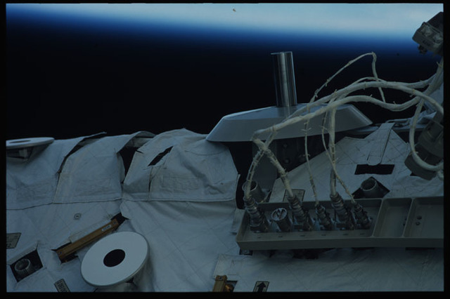 STS110-327-029 - STS-110 - View of a Grapple Fixture and an Avionics Panel on the S0 Truss taken during STS-110