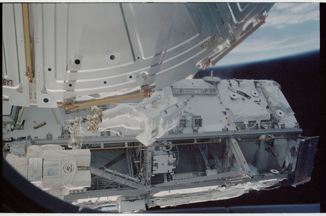 STS110-341-032 - STS-110 - MS Walheim at work during the first EVA of STS-110
