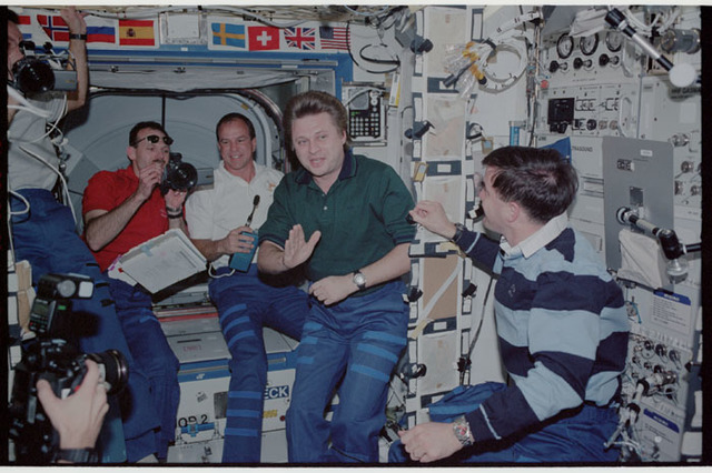 STS110-353-007 - STS-110 - STS-110 and Expedition Four crews in Destiny during STS-110's initial ingress into the ISS