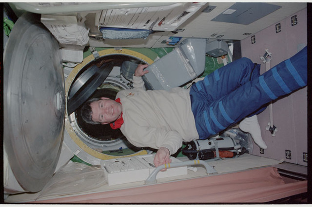 STS110-353-031 - STS-110 - Pilot Frick poses in the Service Module during STS-110