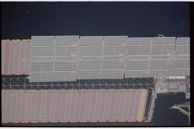 STS110-363-021 - STS-110 - View of the port Solar Arrays of the Service Module and P6 Truss taken during STS-110