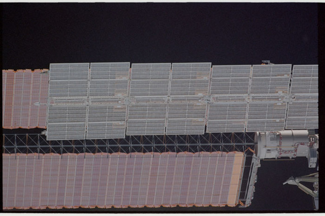 STS110-363-022 - STS-110 - View of the port Solar Arrays of the Service Module and P6 Truss taken during STS-110