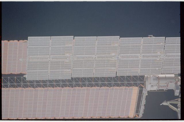 STS110-363-023 - STS-110 - View of the port Solar Arrays of the Service Module and P6 Truss taken during STS-110