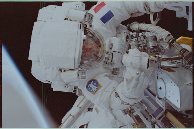 STS111-307-029 - STS-111 - Upper torso view of Perrin photographing the MBS during STS-111 UF-2 EVA 2