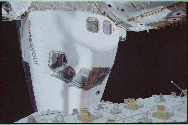 STS111-309-016 - STS-111 - Endeavour's nose with Lockhart waving in AFD window photographed during STS-111 UF-2 EVA 2