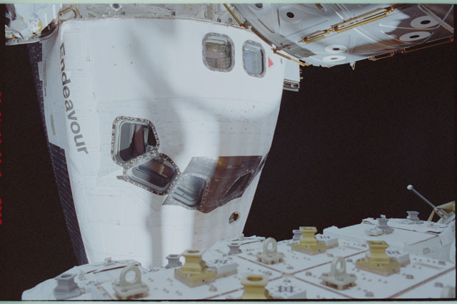 STS111-309-017 - STS-111 - Endeavour's nose with Lockhart waving in AFD window photographed during STS-111 UF-2 EVA 2