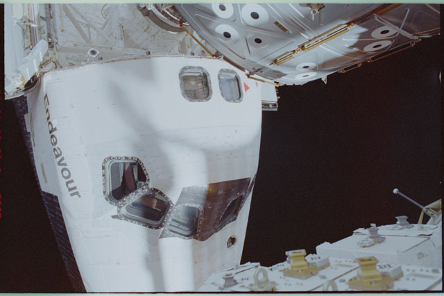 STS111-309-019 - STS-111 - Endeavour's nose with Lockhart waving in AFD window photographed during STS-111 UF-2 EVA 2
