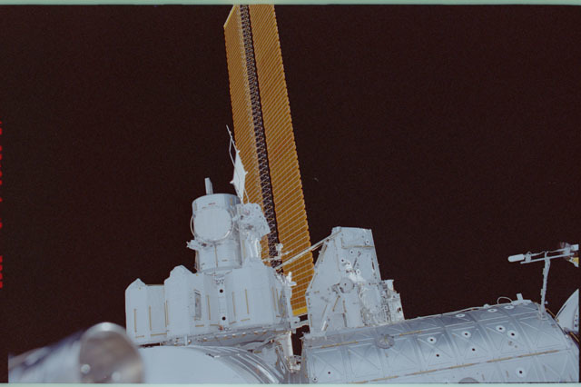 STS111-310-018 - STS-111 - Perrin positioned next to hatch on Quest Airlock during STS-111 UF-2 EVA 1