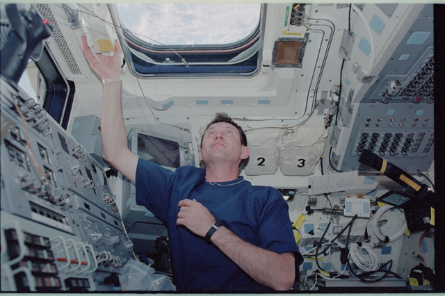 STS111-315-001 - STS-111 - Treschev peers through an overhead window on Endeavour's AFD during STS-111 UF-2
