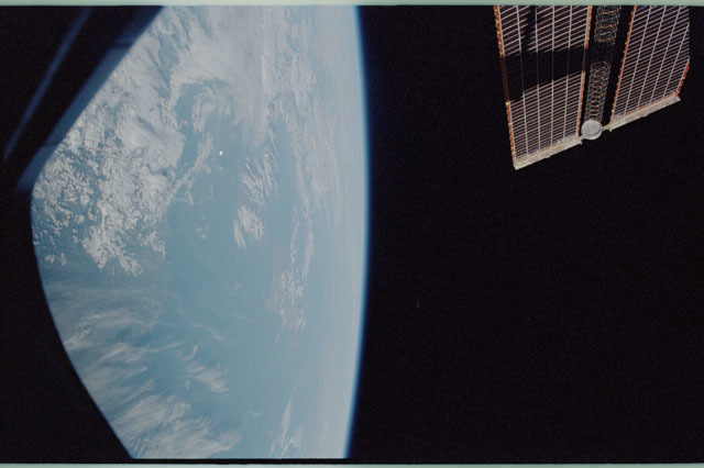 STS111-319-017 - STS-111 - Earth observation and PV array view taken during STS-111 approach for docking to the ISS