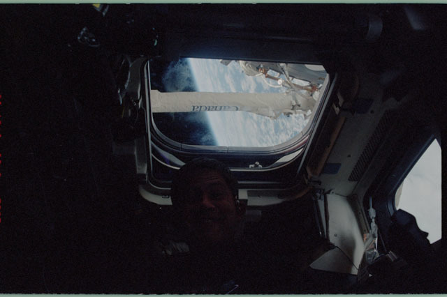 STS111-322-017 - STS-111 - Lockhart on Endeavour's AFD with SSRMS 'Canada' in window above him during Mission STS-111