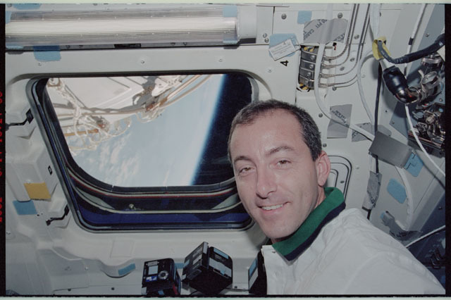 STS111-343-003 - STS-111 - Perrin poses beside a window on Endeavour's AFD during STS-111