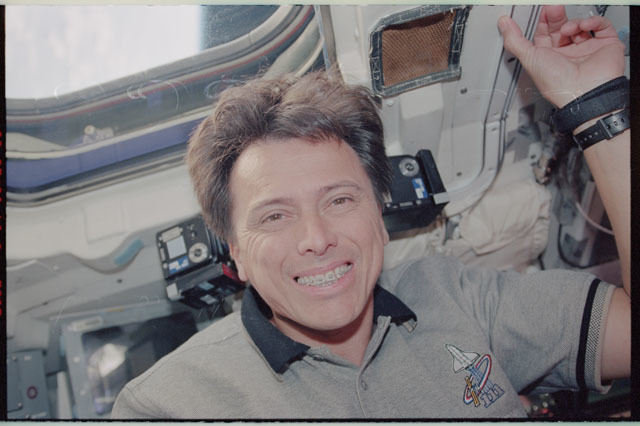 STS111-343-005 - STS-111 - Chang-Diaz smiles from below a window on Endeavour's AFD during STS-111 UF-2