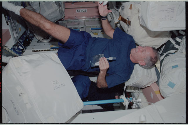 STS111-343-024 - STS-111 - Cockrell in Node 1 during STS-111 UF-2 cargo transfer OPS to the ISS