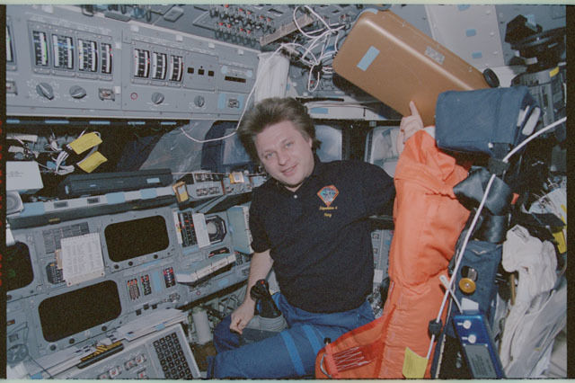 STS111-358-011 - STS-111 - Onufrienko smiles from the PLT's seat on Endeavour during STS-111 UF-2