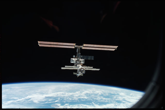 STS111-373-006 - STS-111 - Aft zenith view of the ISS above the Earth's limb taken during STS-111 UF-2 Flyaround