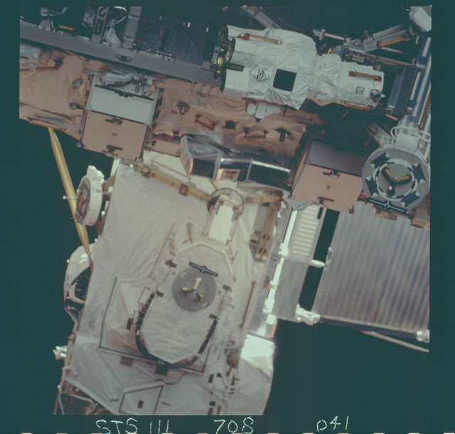 STS111-708-041 - STS-111 - PDGFs and the LEE POA on the MBS, image taken during mission STS-111 UF-2