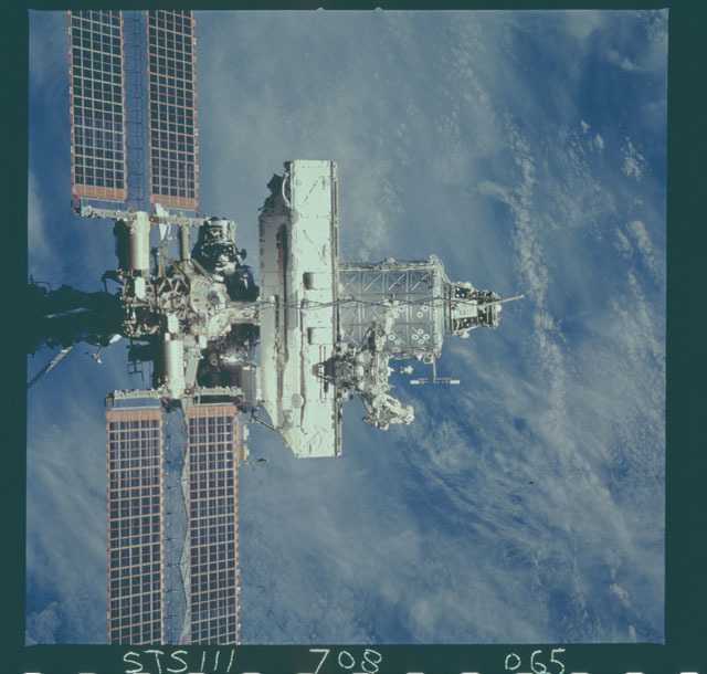 STS111-708-065 - STS-111 - Zenith view of the ISS backdropped against the Earth taken during STS-111 UF-2 Flyaround