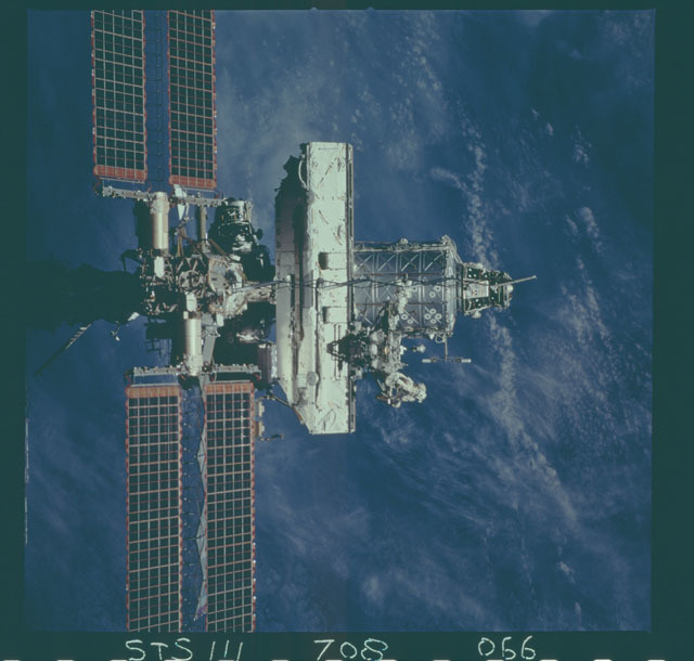 STS111-708-066 - STS-111 - Zenith view of the ISS backdropped against the Earth taken during STS-111 UF-2 Flyaround