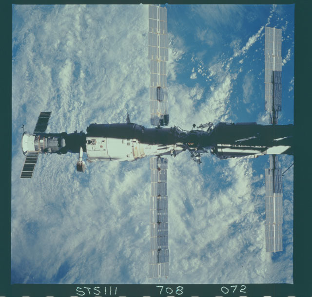 STS111-708-072 - STS-111 - Zenith view of the ISS backdropped against the Earth taken during STS-111 UF-2 Flyaround