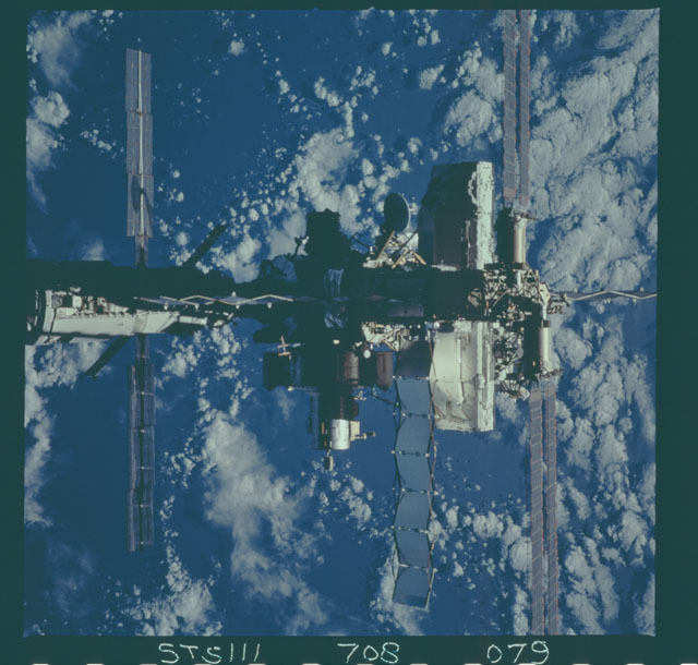 STS111-708-079 - STS-111 - Zenith view of the ISS backdropped against the Earth taken during STS-111 UF-2 Flyaround