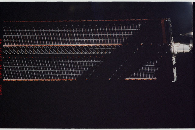 STS112-313-009 - STS-112 - Flyaround view of the port Solar Array Wing of the P6 Truss