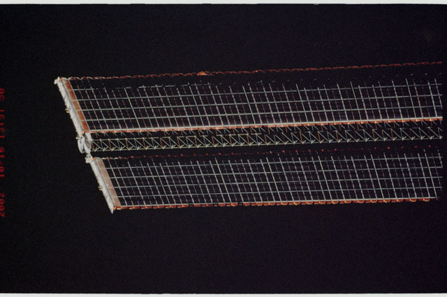 STS112-313-010 - STS-112 - Flyaround view of the port Solar Array Wing of the P6 Truss