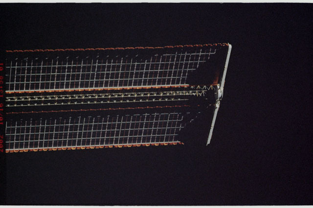 STS112-313-011 - STS-112 - Flyaround view of the starboard Solar Array Wing of the P6 Truss