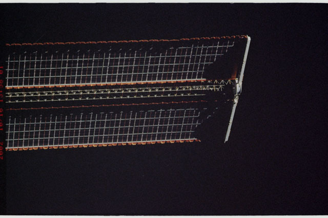 STS112-313-012 - STS-112 - Flyaround view of the starboard Solar Array Wing of the P6 Truss