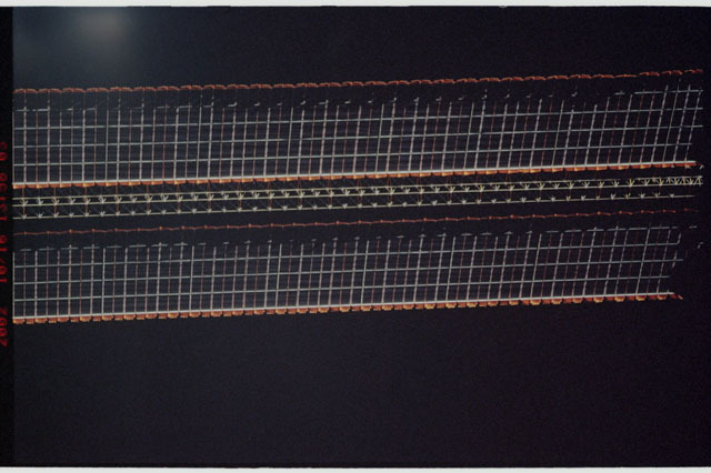 STS112-313-013 - STS-112 - Flyaround view of the starboard Solar Array Wing of the P6 Truss