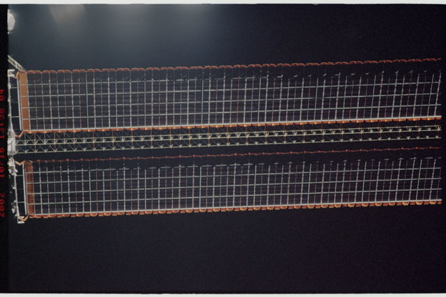 STS112-313-014 - STS-112 - Flyaround view of the starboard Solar Array Wing of the P6 Truss