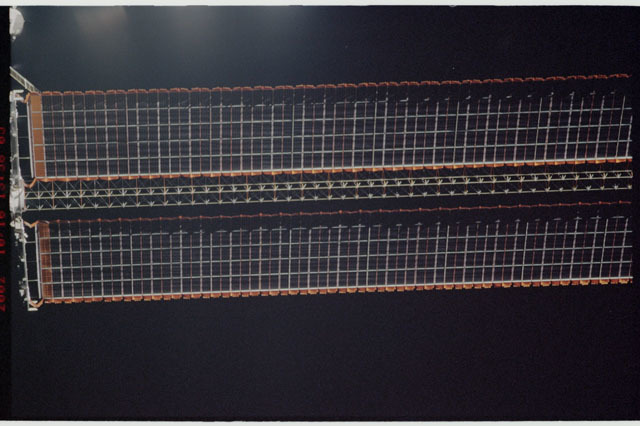 STS112-313-015 - STS-112 - Flyaround view of the starboard Solar Array Wing of the P6 Truss