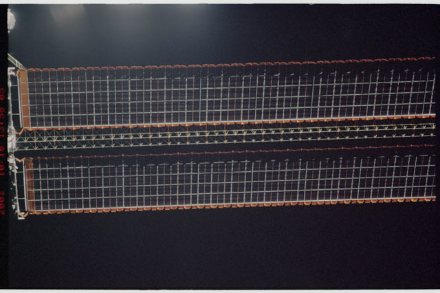 STS112-313-016 - STS-112 - Flyaround view of the starboard Solar Array Wing of the P6 Truss