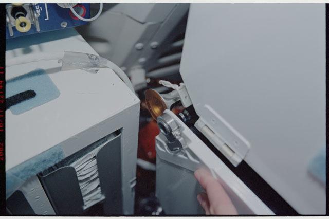 STS112-324-021 - STS-112 - Broken corner bolt on Atlantis middeck locker