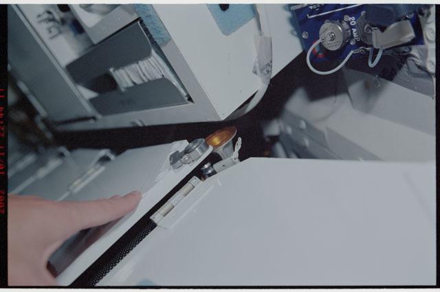 STS112-324-022 - STS-112 - Broken corner bolt on Atlantis middeck locker