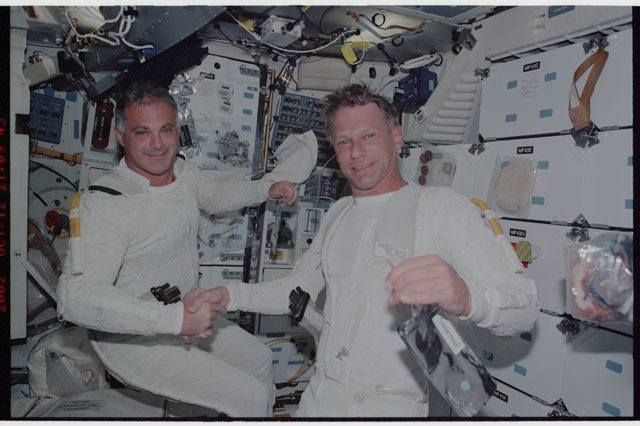 STS112-331-010 - STS-112 - STS-112 MS Wolf and Sellers wearing LCVGs on middeck