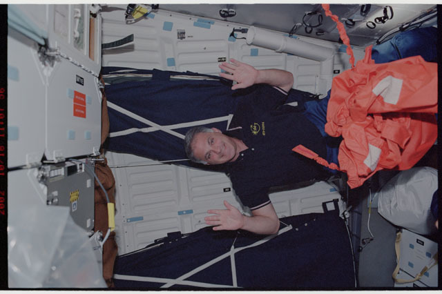 STS112-337-016 - STS-112 - STS-112 MS Wolf on middeck prior to return to KSC