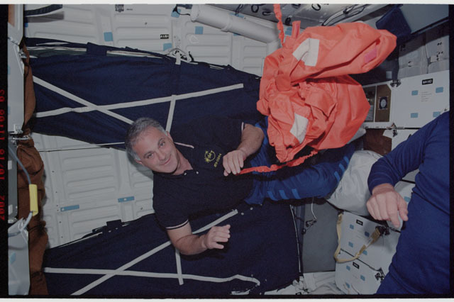 STS112-337-017 - STS-112 - STS-112 MS Wolf on middeck prior to return to KSC