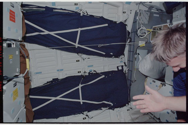 STS112-337-018 - STS-112 - Sleep restraints on middeck prior to return to KSC