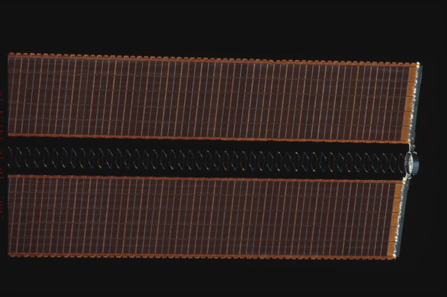STS112-374-028 - STS-112 - Flyaround view of the starboard Solar Array Wing of the P6 Truss