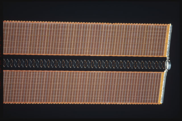 STS112-374-029 - STS-112 - Flyaround view of the starboard Solar Array Wing of the P6 Truss
