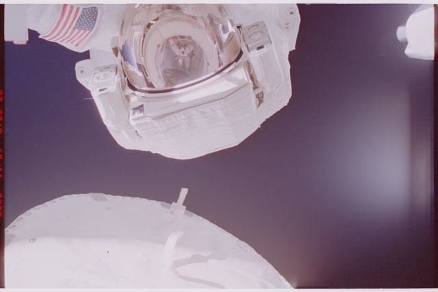 STS113-308-007 - STS-113 - Herrington reflected in Lopez-Alegria's EMU visor during STS-113 EVA 2