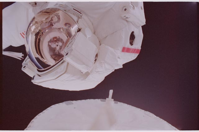 STS113-308-008 - STS-113 - Herrington reflected in Lopez-Alegria's EMU visor during STS-113 EVA 2