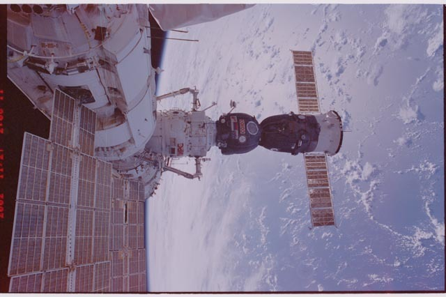 STS113-309-031 - STS-113 - FGB, SM, Pirs DC, and Soyuz seen during STS-113 EVA 1