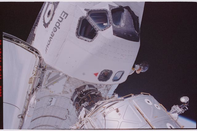 STS113-310-005 - STS-113 - Lockhart in Endeavour's AFD window during STS-113 EVA 2