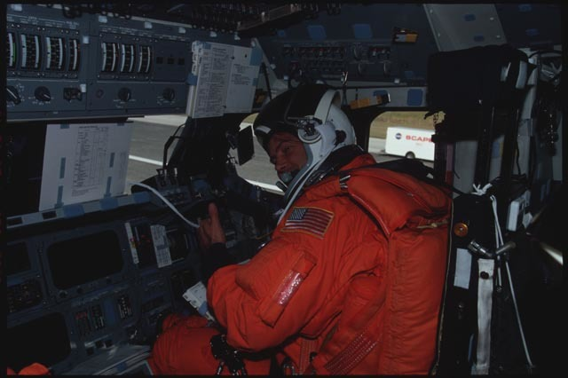 STS113-321-004 - STS-113 - View of PLT Lockhart seated at his FD workstation on KSC Runway post landing for STS-113
