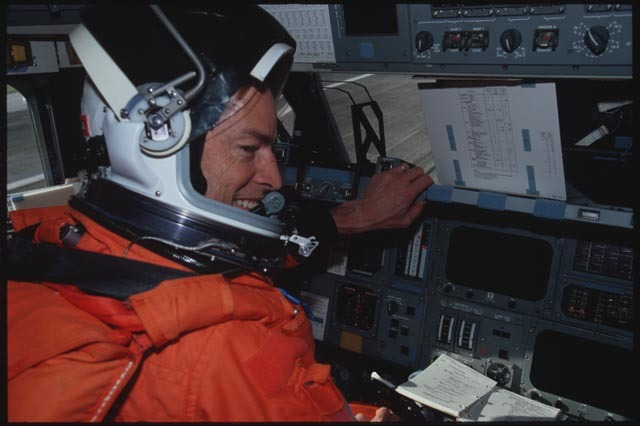 STS113-321-005 - STS-113 - View of CDR Wetherbee seated at his FD workstation on KSC Runway post landing for STS-113