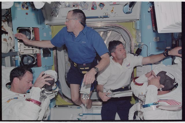 STS113-340-025 - STS-113 - Herrington, Lopez-Alegria, Lockhart and Pettit during STS-113 EVA 2 EMU don in Quest A/L
